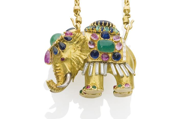 Lot 323, Gold elephant pendant by Rene Boivin, decorated with sapphires, emeralds and diamonds. Estimate €20,000 - €30,000. SOLD FOR €109,000