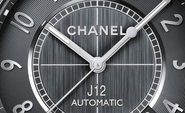 Close-up of dial of the Chanel J12 Chromatic watch. Self-winding mechanical movement. Functions: hours, minutes, seconds, date. 42-hour power reserve. Unidirectional rotating bezel. Screw-down crown, water-resistance 200 meters. 41mm diameter