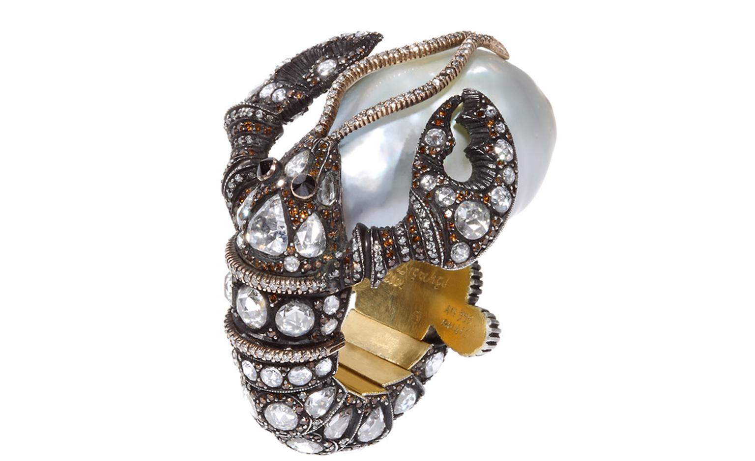 A lobster cradling a baroque pearl slips onto the finger in this Sevan Biçakçi ring.