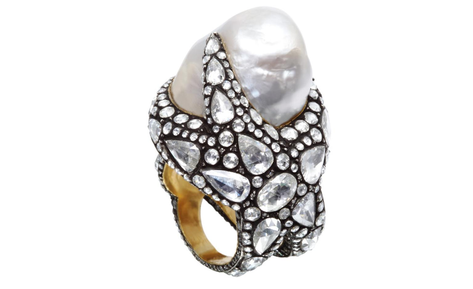 More marine inspiration in this Sevan Biçakçi ring that wraps a starfish around the finger topped by a gorgeous baroque pearl. Rose-cut diamonds stand out against the oxidised metal.