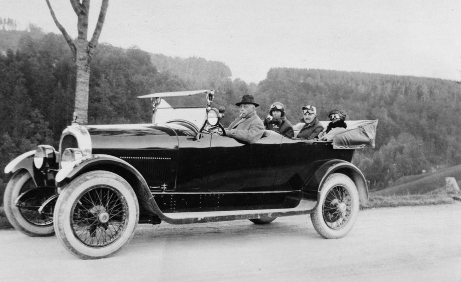 The Heuer family out and about in their automobile.