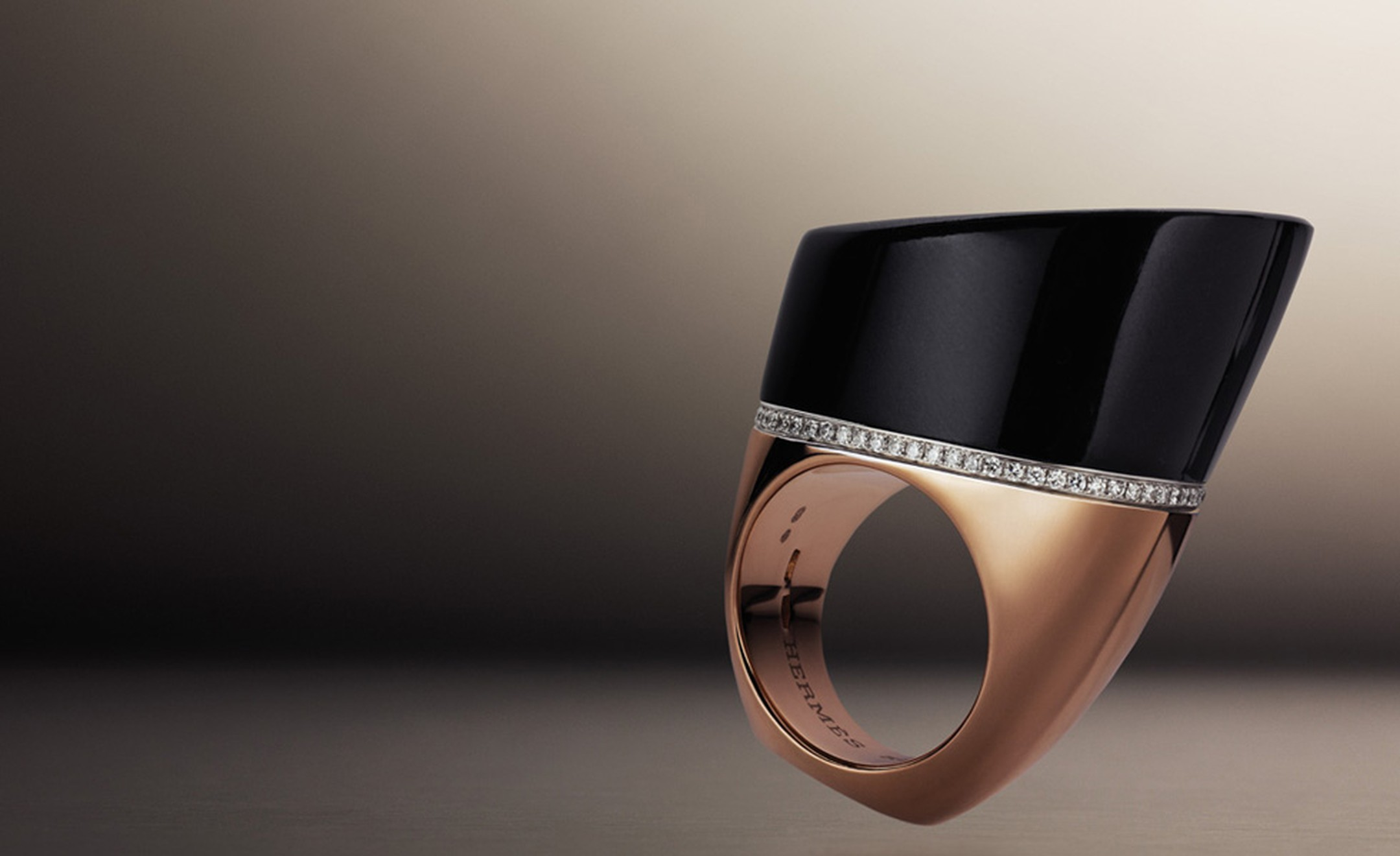 Hermès Centaure ring in rose gold with black jade and diamonds.The rings all have flat bottoms so that it can be displayed like a sculpture.