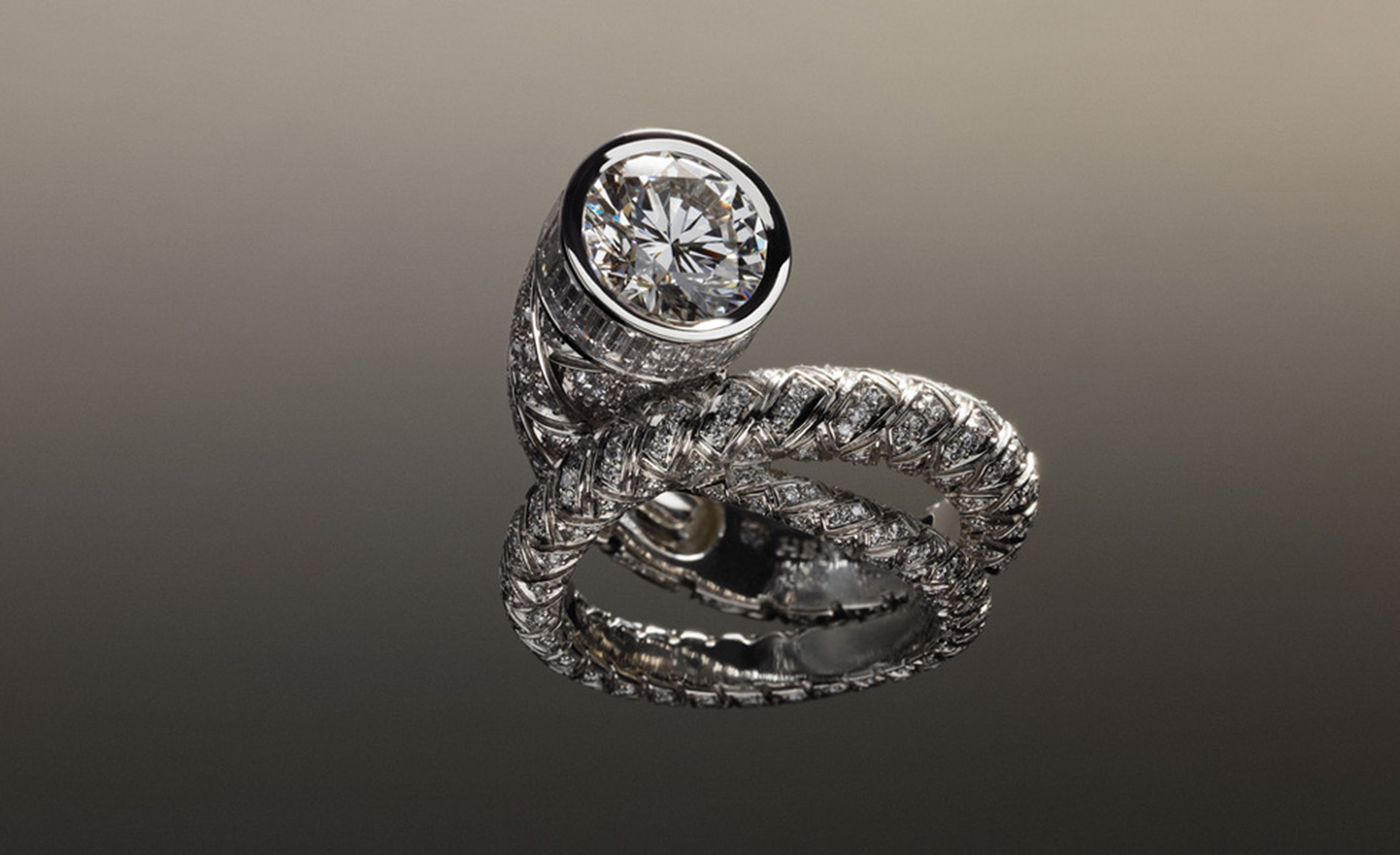 Hermès Fouet ring in platinum with diamonds.