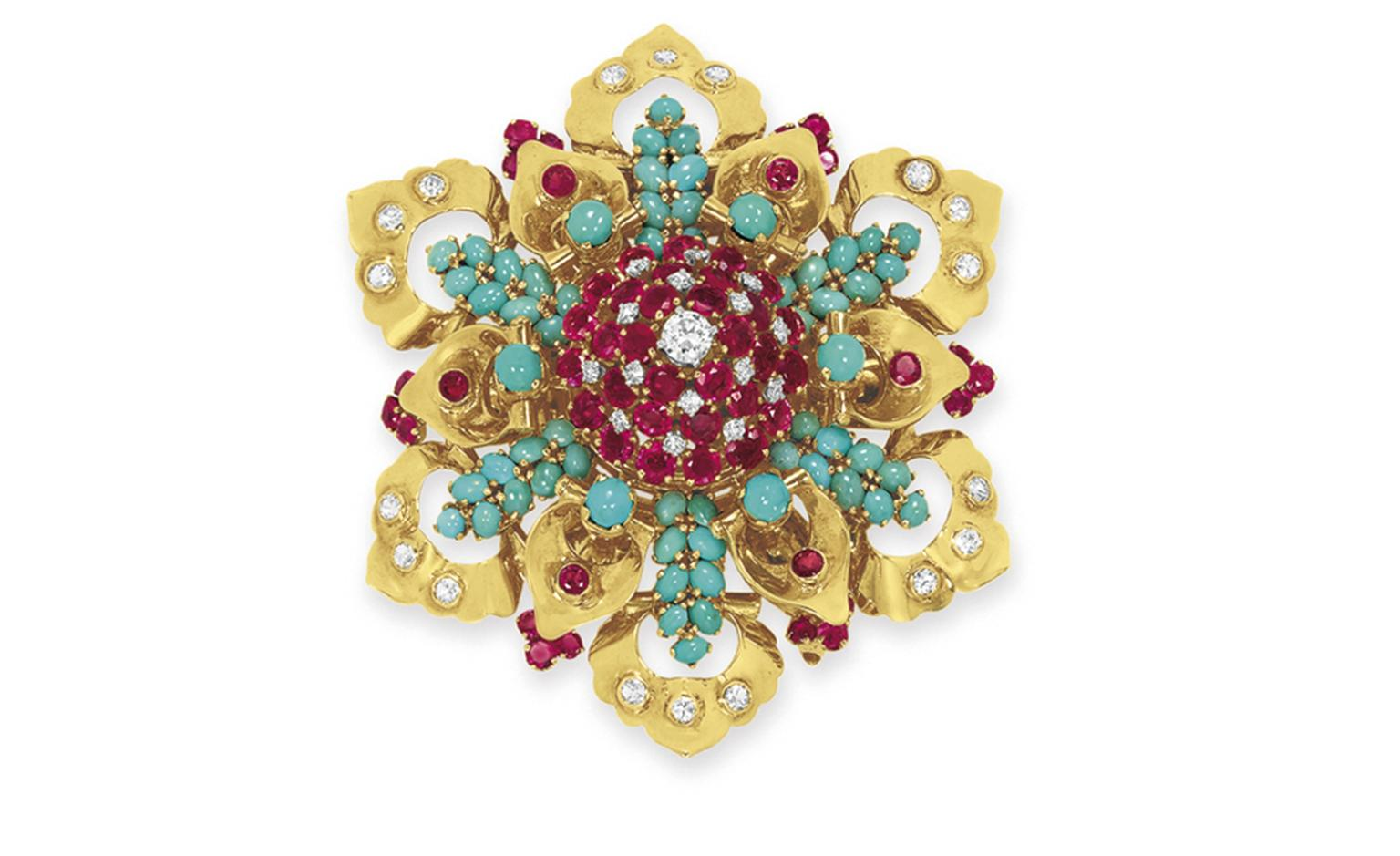 Lot 10. A diamond, ruby, turquoise and gold brooch, by John Rubel Co. Estimate 3,000 - 5,000 U.S. dollars