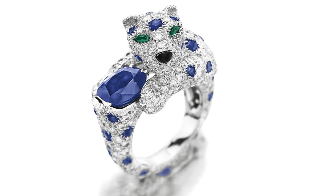 Lot 78. A diamond sapphire and emerald ''panther'' ring, by Cartier. Estimate 20,000 - 30,000 U.S. dollarsLot 78. A diamond sapphire and emerald ''Panther'' ring, by Cartier. Estimate 20,000 - 30,000 U.S. dollars. SOLD FOR $122,500
