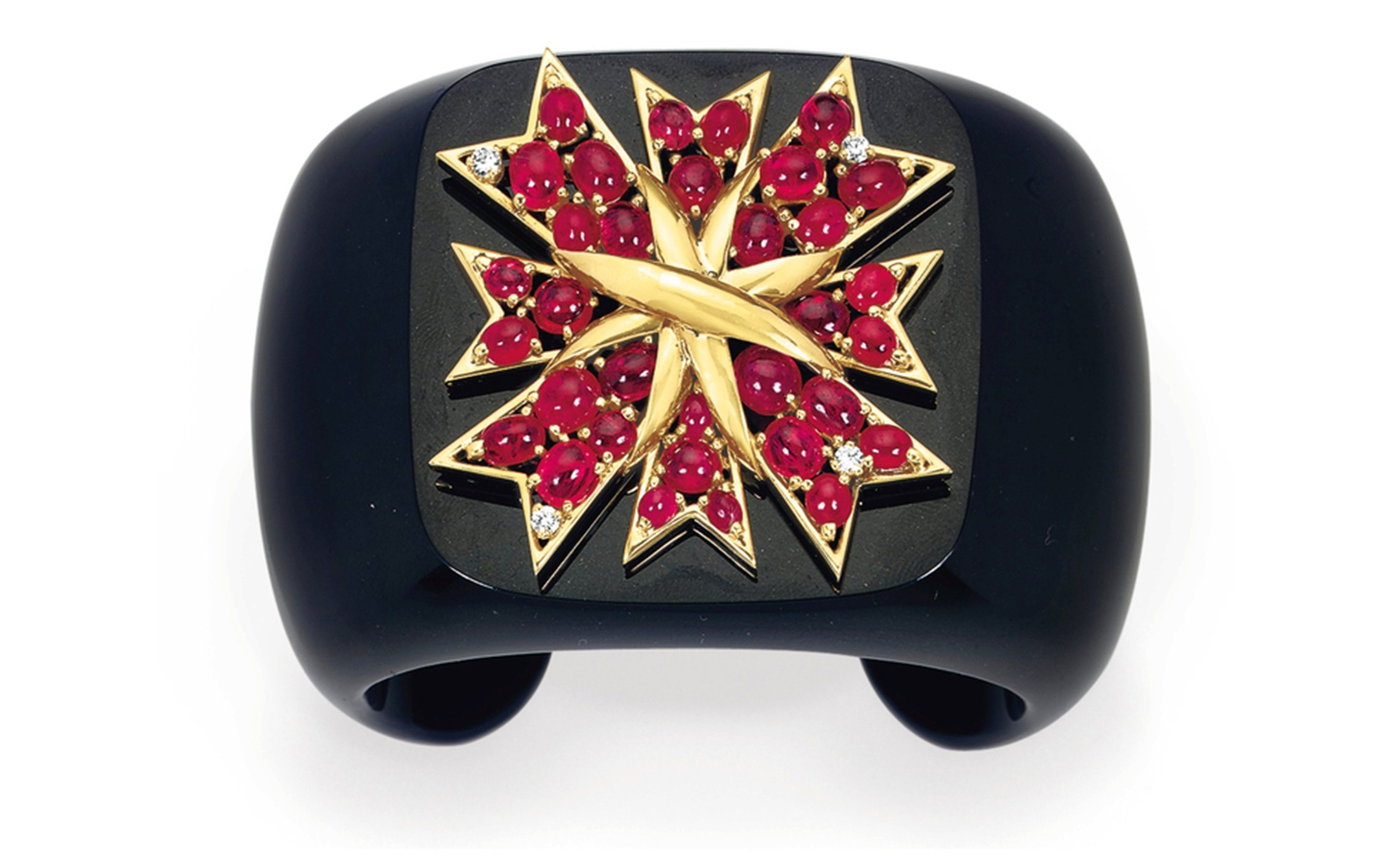 Lot 31. A diamond, ruby, onyx and gold cuff, by Verdura. Estimate 20,000 - 30,000 U.S. dollars. SOLD FOR $32,500