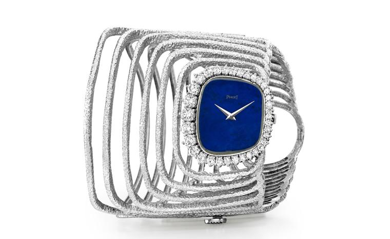 Piaget Cuff 1970 watch in white gold with lapis lazuli dial and bezel set with diamonds.  Piaget ultra-thin hand wound 9P movement. Piaget Private Collection.