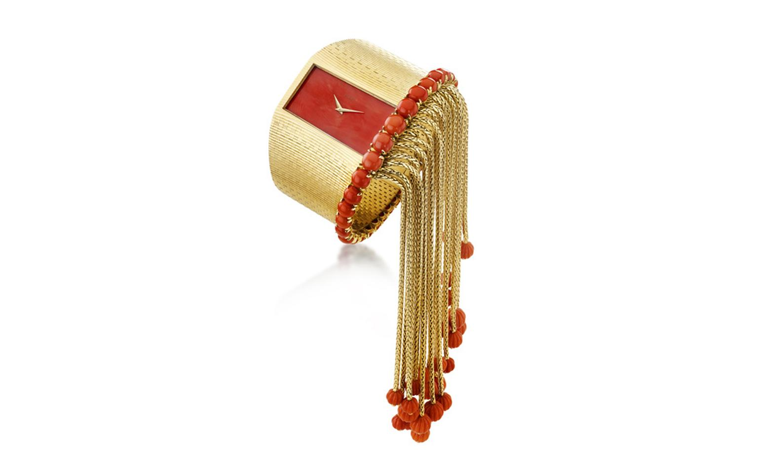 Yellow gold and red coral watch by Piaget made in 1974 with the Piaget ultra-thin Calibre 9P movement.