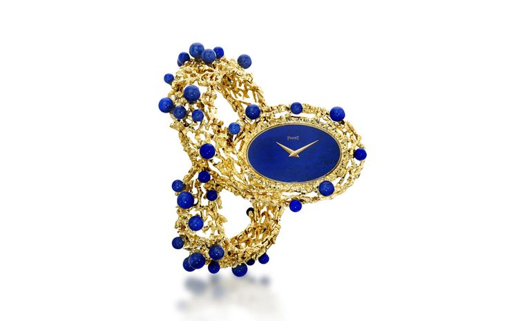 Piaget 1971 cuff watch in yellow gold with lapis lazuli dial and lapis lazuli beads with ultra-thin hand wound movement. Piaget Private Collection.