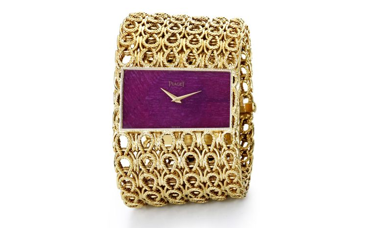Piaget Cuff 1970 yellow gold cuff watch with ruby dial and Piaget ultra-thin mechanical movement 9P. Piaget Private Collection.