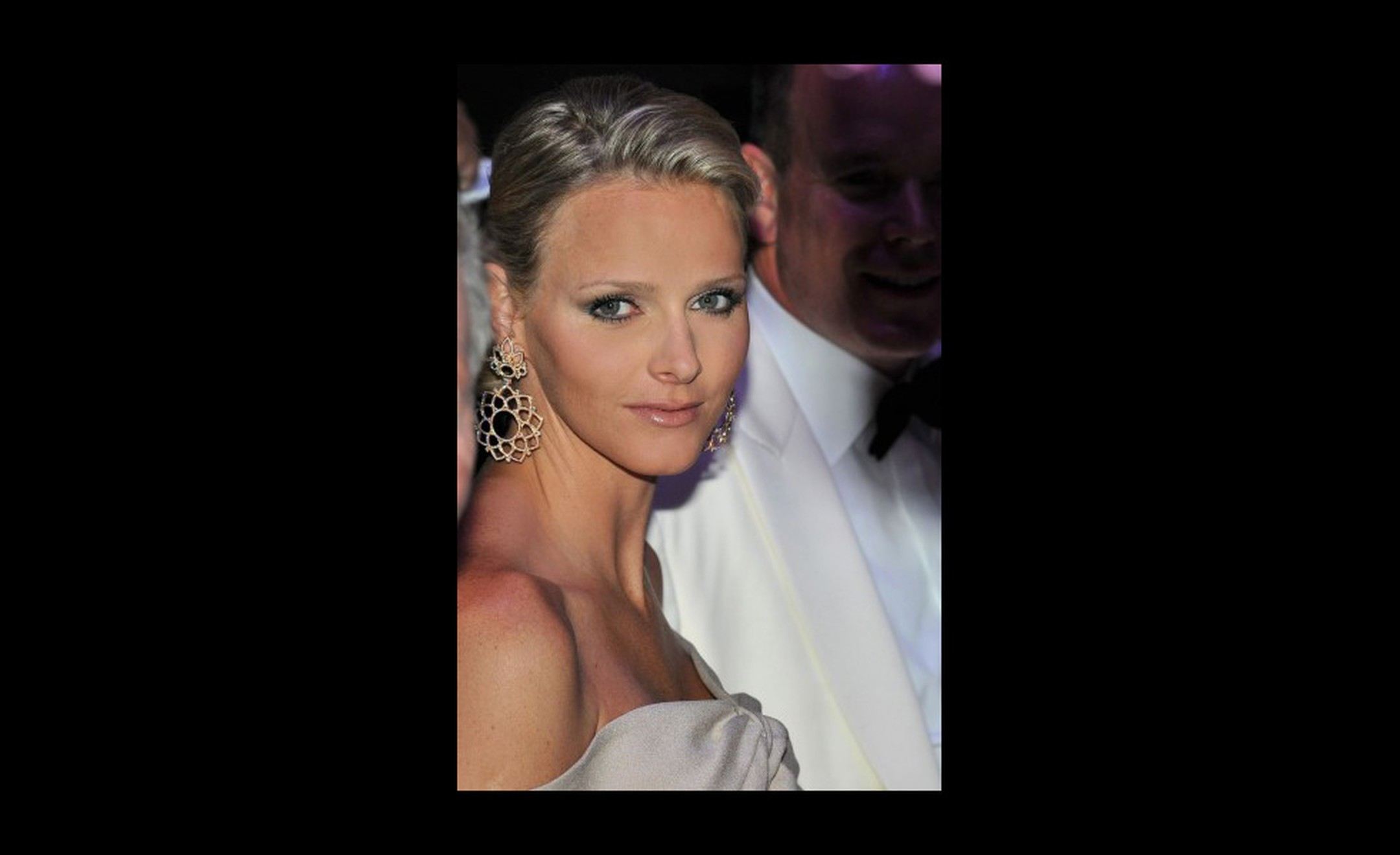 Big earring statement from Charlene Wittstock. I like the way she wears just the earrings and avoids the Christmas tree look. Photo: Prince's Palace of Monaco