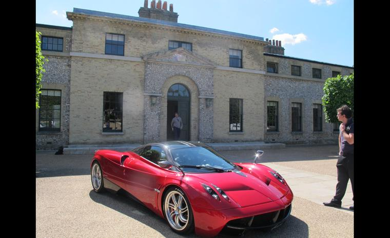 Here you are, at last, a picture of a complete car. This red roarer was outside the entrance to The Kennels golf club and I believe it is a Pagani.