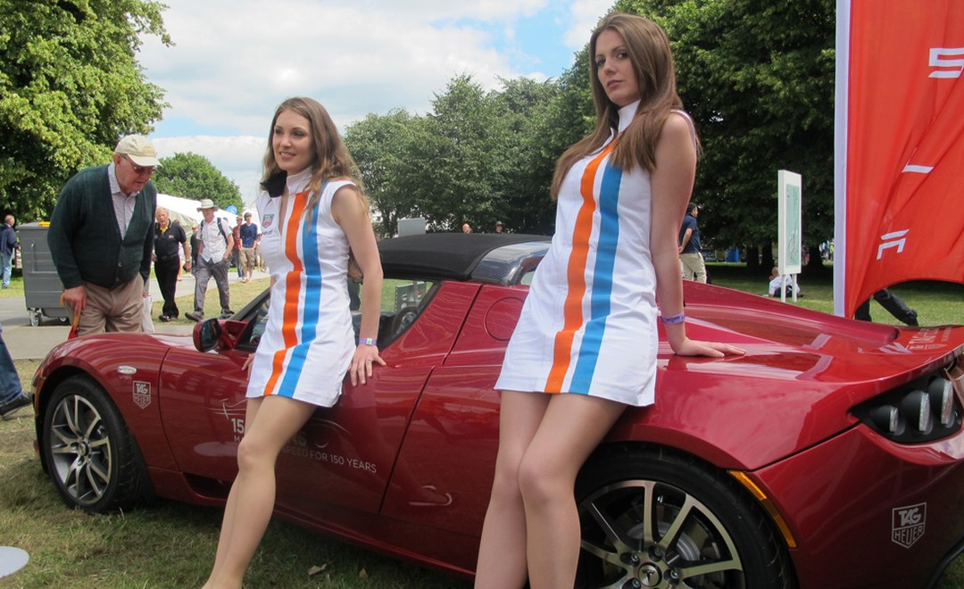 And the girls are out in their Gulf racing stripes for TAG Heuer and leaning against the Tesla eco-sports mobile.