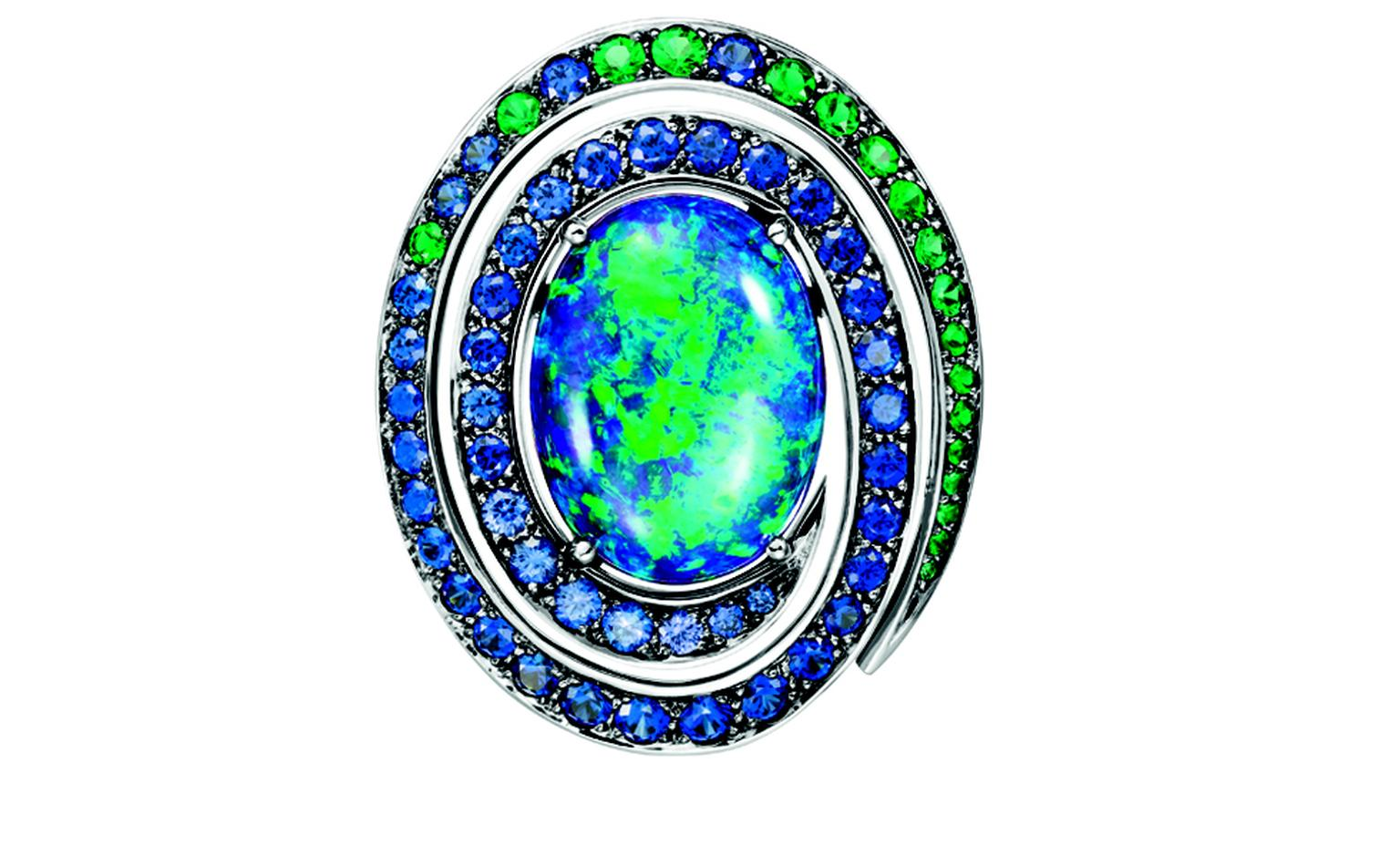 BOUCHERON. Aiguebelle earrings, set with an oval opal cabochon, paved with emeralds, blue and purple sapphires, on white gold. POA