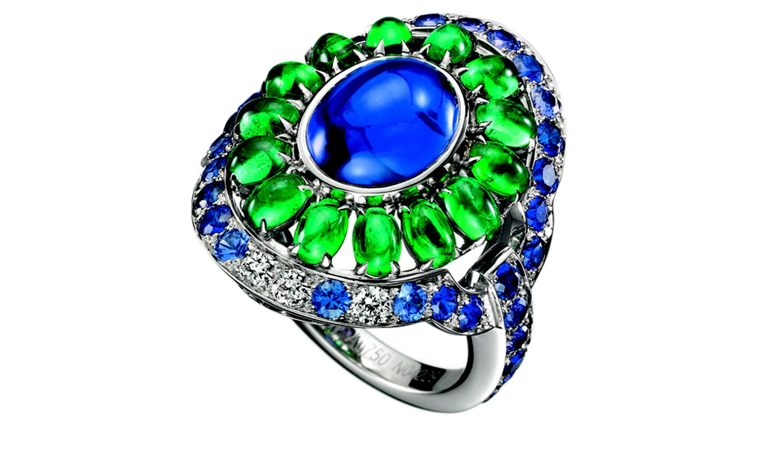 BOUCHERON. Capriccioli ring, set with an oval cabochon sapphire, paved with emerald beads, blue and purple sapphires and diamonds, on white gold. POA