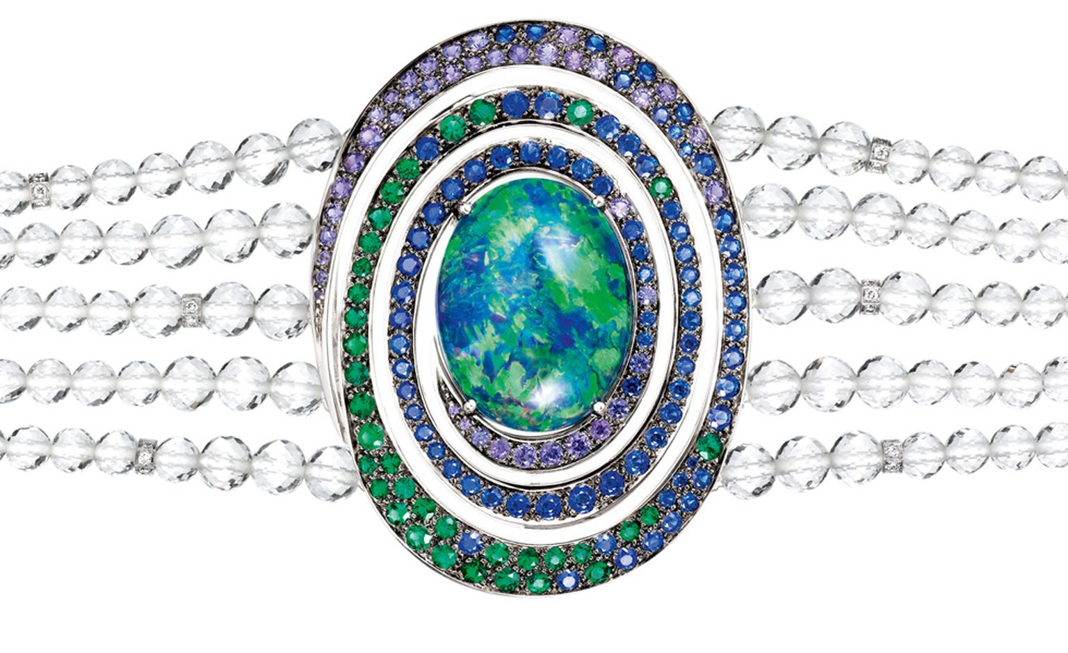 Aiguebelle  bracelet,  set  with  an  oval  opal  cabochon   and  rock  crystal  beads,  set  with  emeralds,  blue  and   purple  sapphires  and  diamonds,  on  white  gold. POA