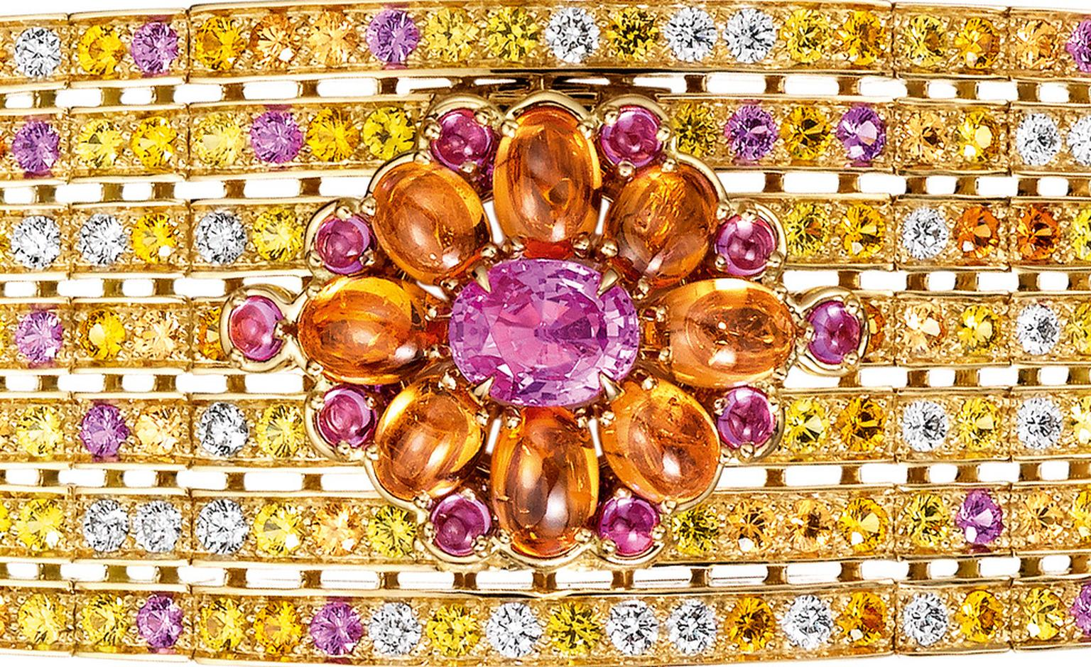 Boucheron close up of the Isola Bella   watch   bracelet,   set   with   a   pink   oval   sapphire   and   pink   and   orange   cabochon       sapphires,   paved   with   yellow,   pink   and   orange   sapphires,   emeralds   and   diamonds, ...