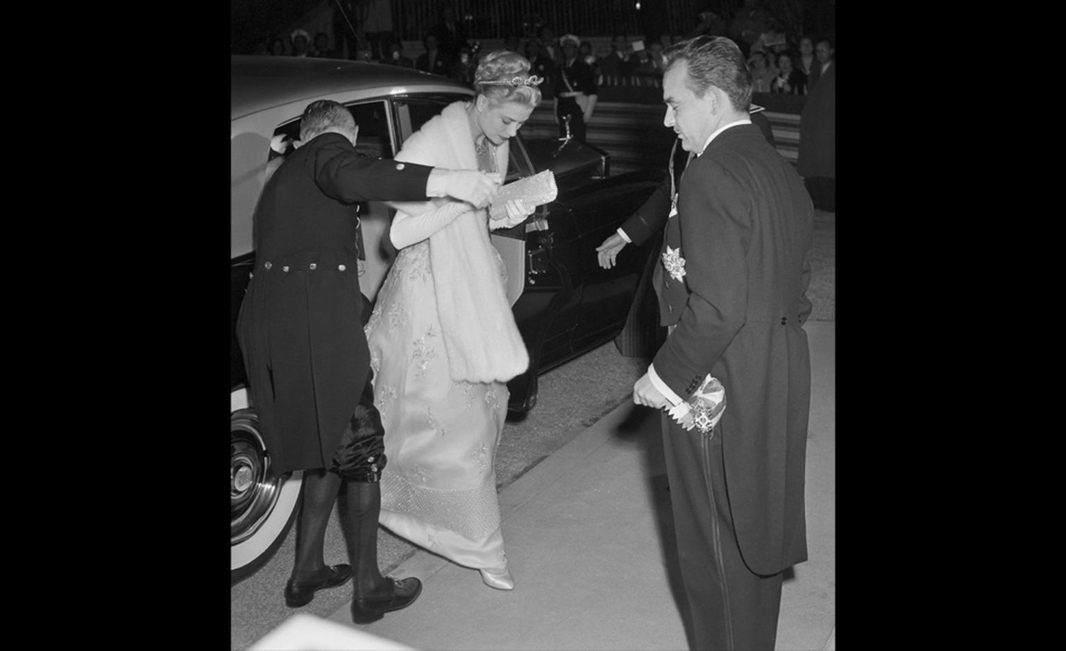 Prince Ranier and actress Grace Kelly arrive for a gala performance at the Royal Opera House April 18th after their civil wedding ceremony earlier in the day.  The actress wore a Cartier sparkling tiara and a diamond and ruby necklace presented ...