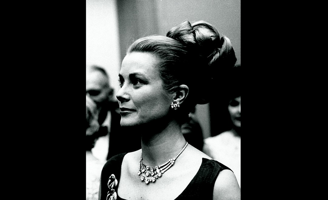Princess Grace of Monaco wearing hair in elaborate bun & adorned w. stunning Cartier diamond necklace, at party.  (Photo by Jack Rosen/Pix Inc./Time Life Pictures/Getty Images)