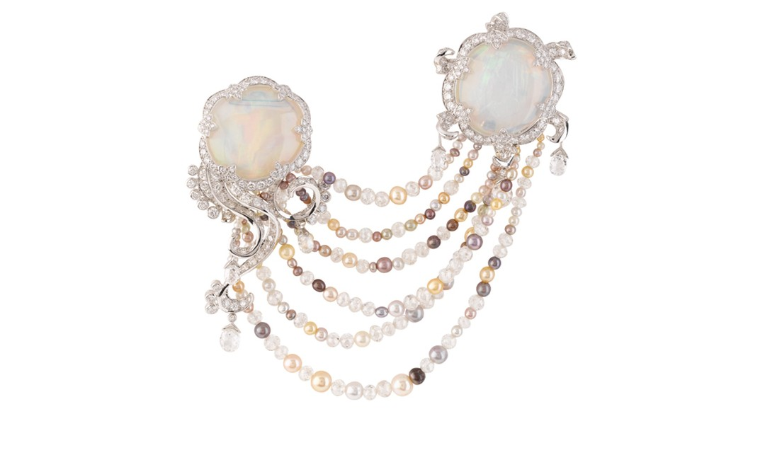 VAN CLEEF & ARPELS. Méduse Lune Clip, Les Voyages Extraordinaires High Jewellery Collection, white gold, round and briolette-cut diamonds, multi-coloured natural pearls, 2 white opals. POA