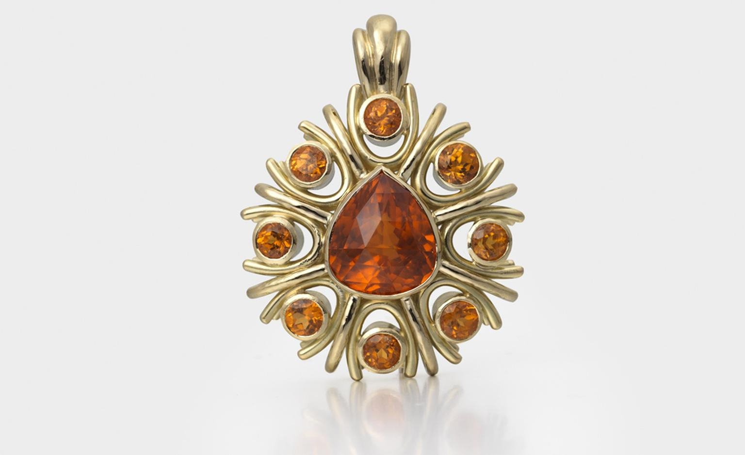 Pendant in 18ct gold set with bright neon mandarin garnets by Jane Sarginson. Price from £17,500