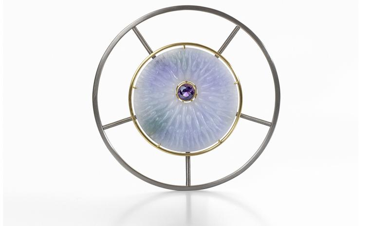 Silipis brooch by Nicholas Yiannarakis. The brooch is made of Burmese Jadeite Jade, a brilliant cut Uruguayan Amethyst, 18ct. Yellow and White Gold. Price from £16,000
