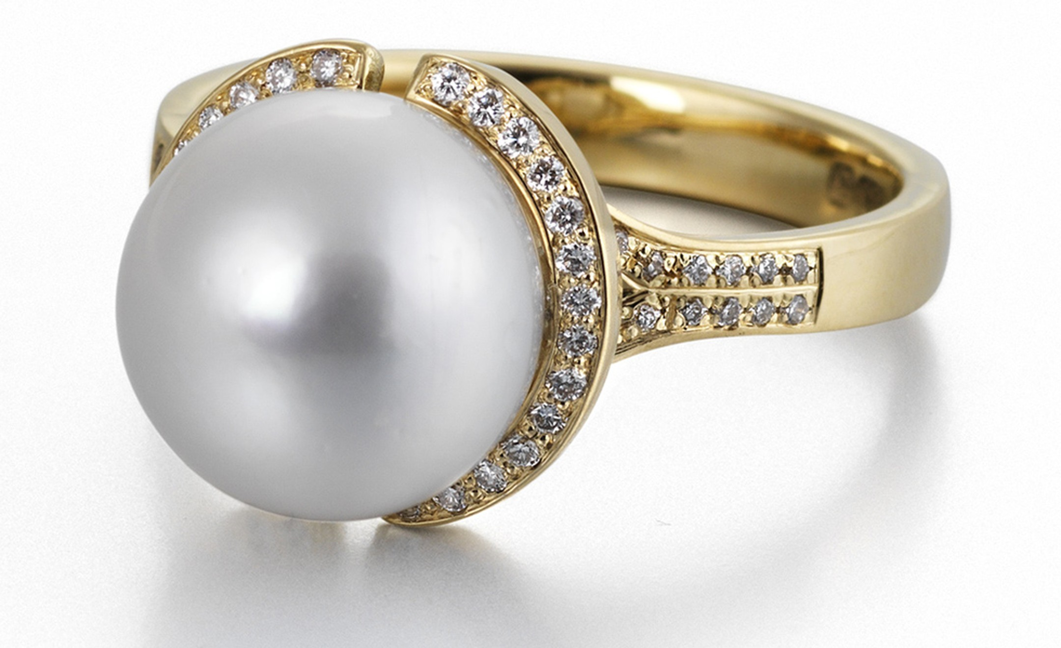 18 carat yellow gold, diamond and south sea pearl ring by James Newman. Price from £2,850
