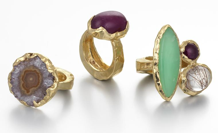"Recent graduate Milly Swire's ""Liquid"" collection. left to right: Rosalie ring, yellow gold set with a rough amethyst. £1,300. Mildred ring, yellow gold set with a cabochon ruby, rutilated quartz and chrysoprase Price from £1,850. Bridget ring, ..."