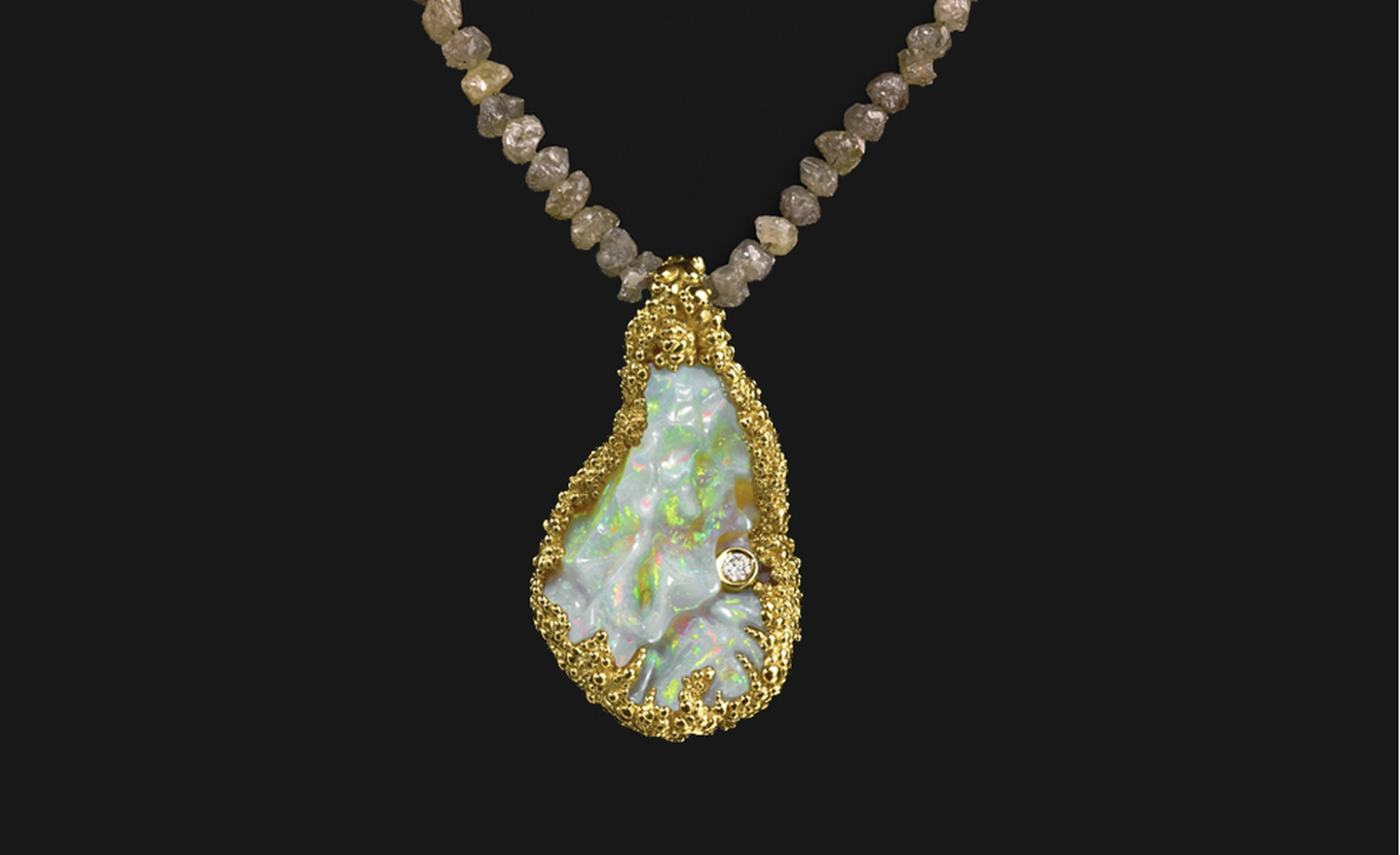 Ornella Iannuzzi: The Blue Nile Falls pendant. Made with a 20 cts hand-carved Wello opal set in 18k gold with a brilliant cut diamond, and mounted on rough diamonds (42cts). Unique Piece. £12,500.