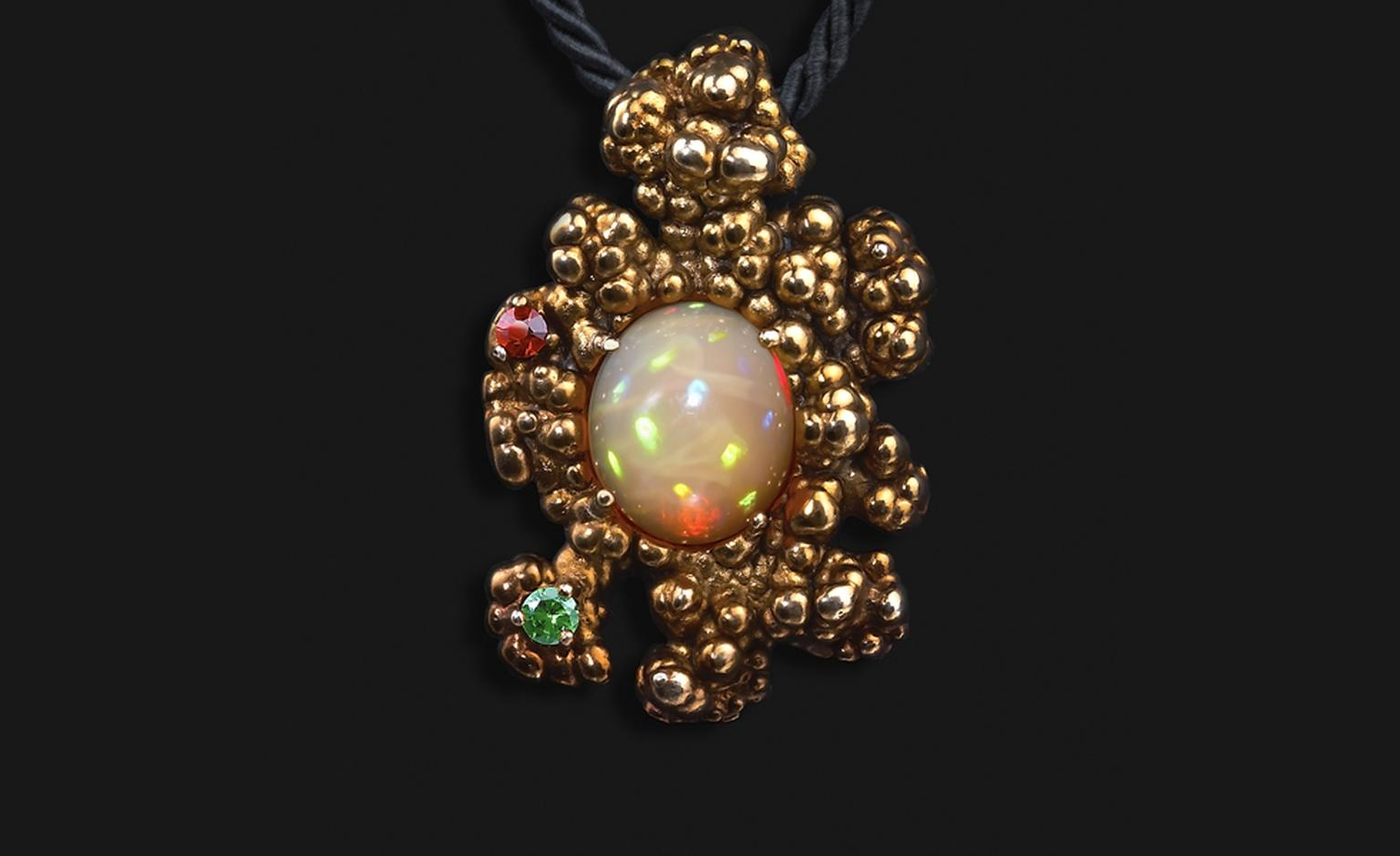 Ornella Iannuzzi: In the beginning, it was all so quiet Pendant. Made with hand-carved Wello opal (4cts) set in gold-plated silver, with garnet & tsavorite. from £1,700.