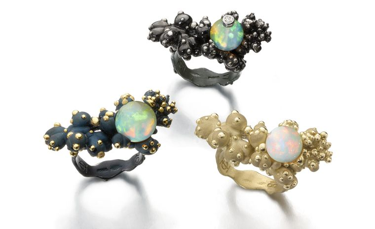 Ornella Iannuzzi: Wello Coral rings. Top ring is in black rhodium plated silver with a diamond on top and a Wello opal sphere, price from £1,100. Left ring is in vermeil with blue silver with a diamond on top and a Wello opal sphere, Price from ...