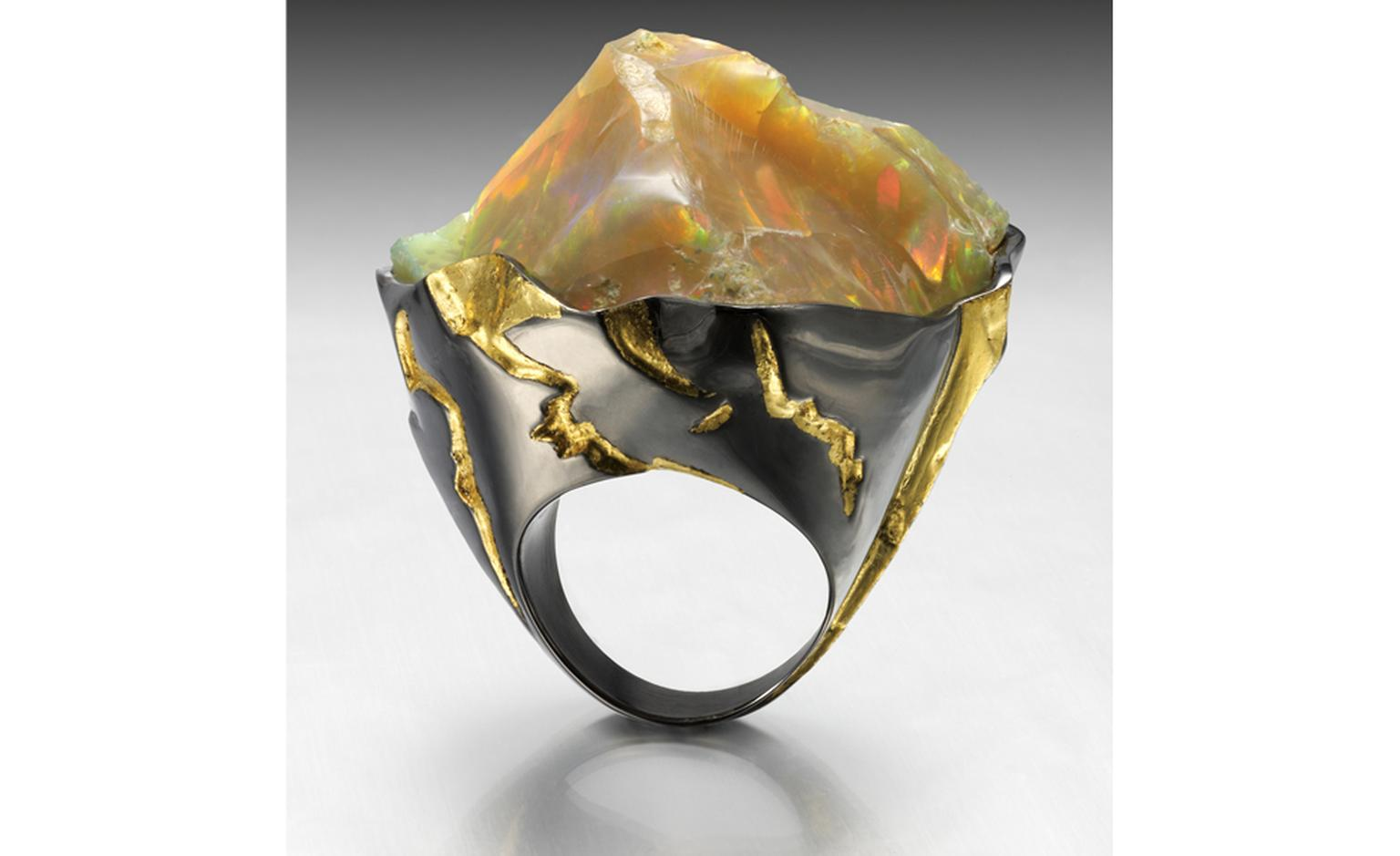 Ornella Iannuzzi: Mount Zion Ring. Made from a 65 cts rough Wello opal set in black silver and decorated with 24ct gold leaves. Unique piece. Model pictured sold - on commission from £2,500.