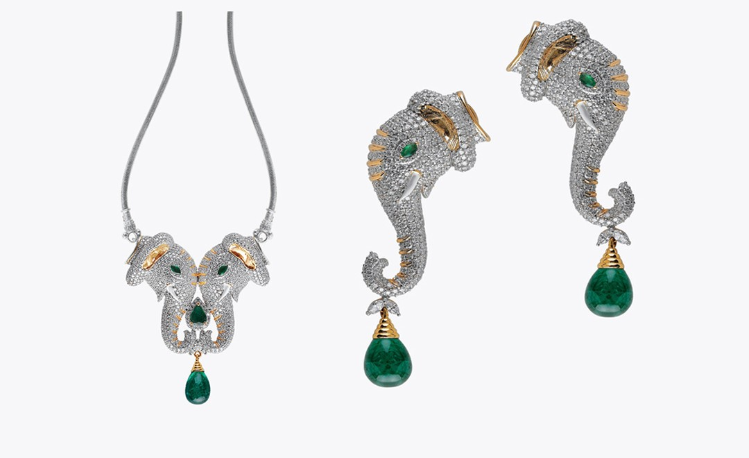 Abaran, Bangalore. Necklace and earrings, Zambian emeralds and diamonds in yellow  gold. Sold as a set, price from $65,000.