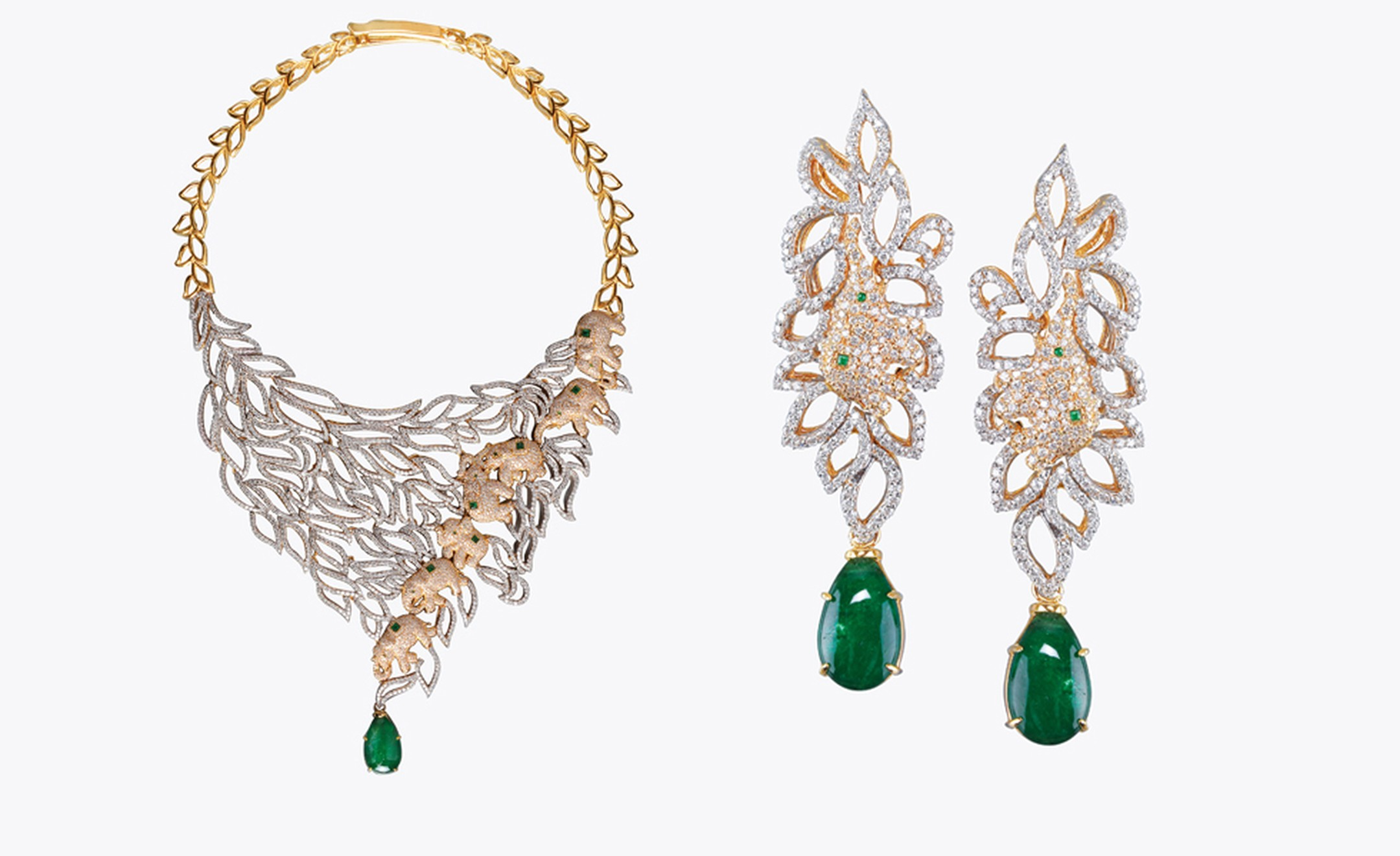 Meena, Hyderabad. Necklace and earrings, Zambian emeralds and diamonds in yellow gold. $60,000.