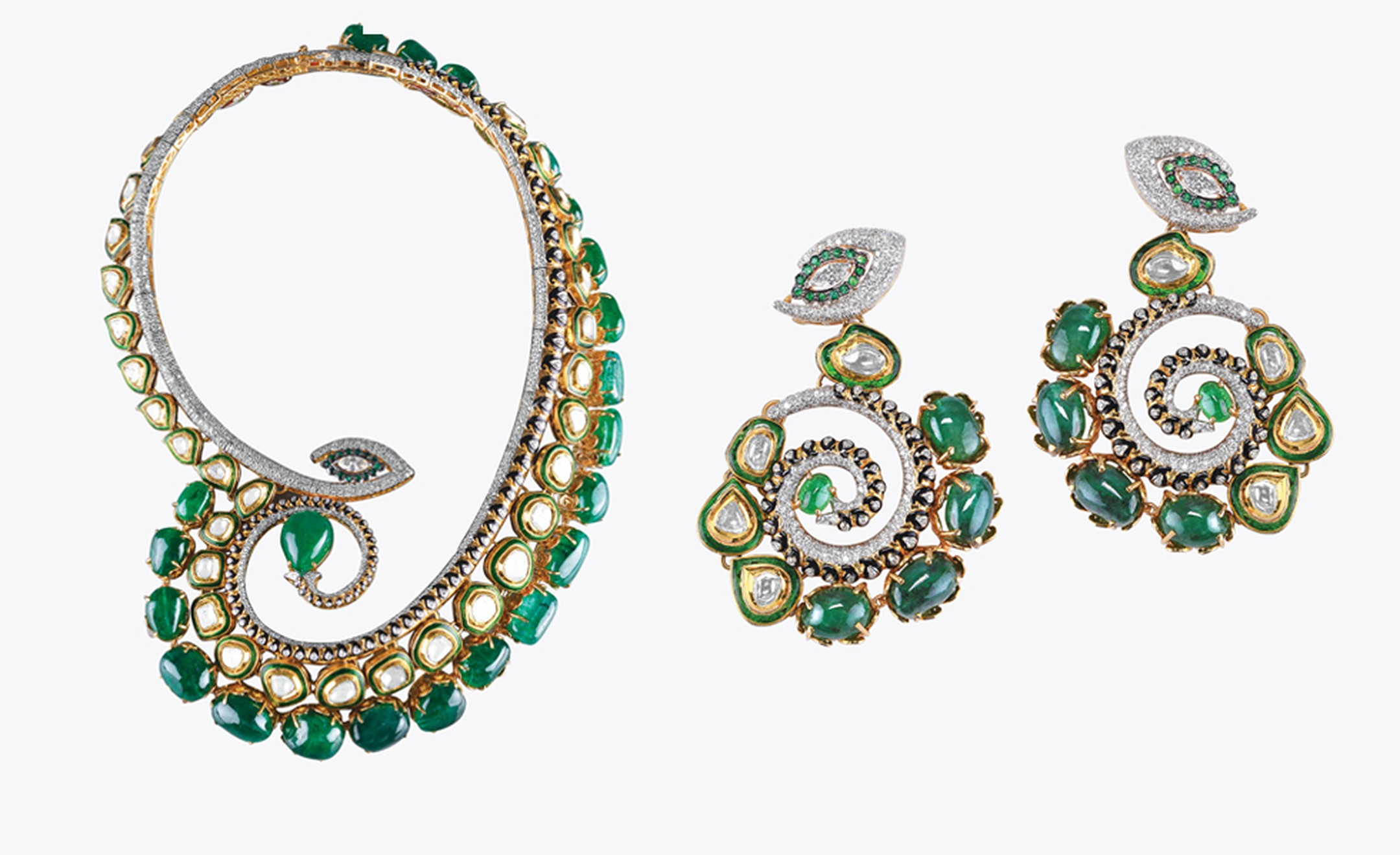 Sawansukha,Kolkata. Necklace and earrings, Zambian emeralds and diamonds in yellow gold. Sold as set, price from $120,00.