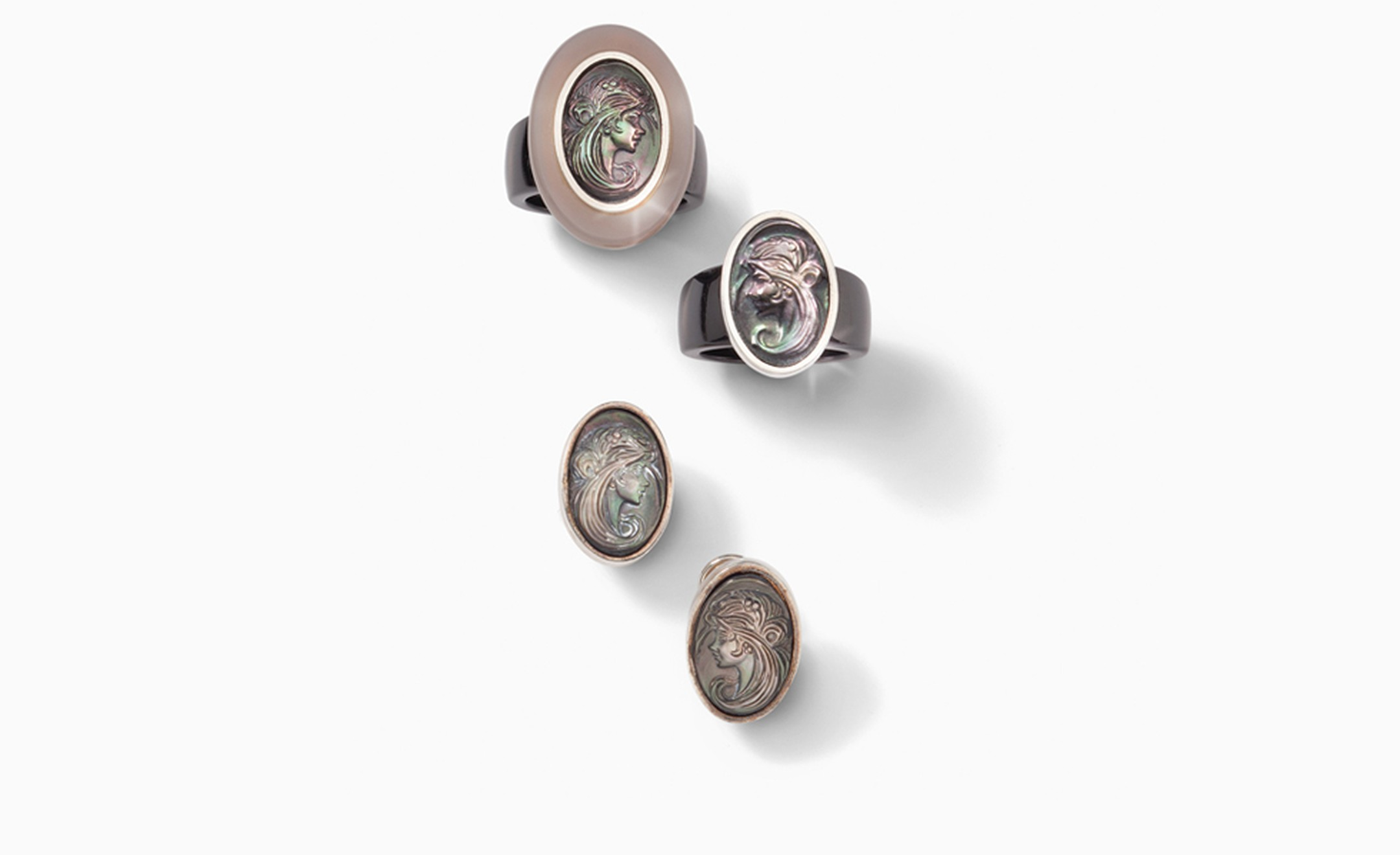 Charlotte Ehinger-Schwarz 1876. Black ceramic ring with agate over mother of pearl and Tahitian mother of pearl cameo. Pair of cameo earrings made out of Tahitian mother of pearl. All pieces sold separatley. Prices start from £230.