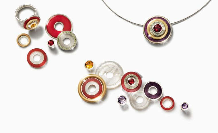 Charlotte Ehinger-Schwarz 1876. Granat-Rot. Earrings, pendants and rings with mother of pearl, gold over sterling silver, peridots set in stainless steel, carnelian over mother of pearl, citrine, amethyst and fire enamel. All pieces sold separat...