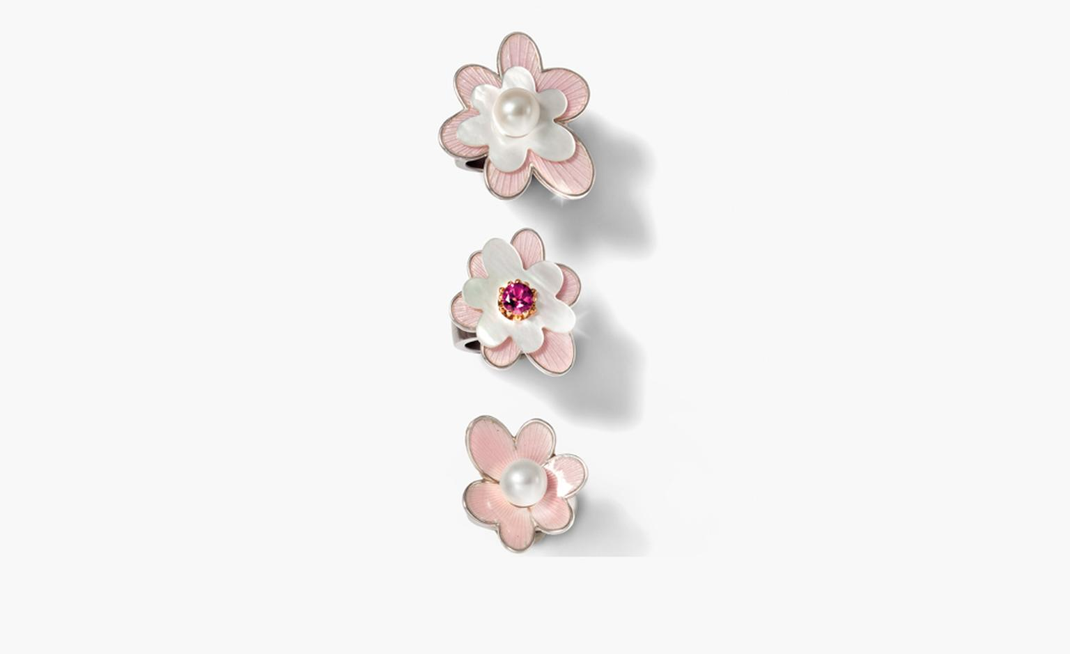 Charlotte Ehinger-Schwarz 1876. Pudrige Bluten. Stainless steel ring with fire enamel flower, mother of pearl flower and fresh water pearl, faceted pink tourmaline set in 18k red gold. All pieces sold separately. Prices start from £347.
