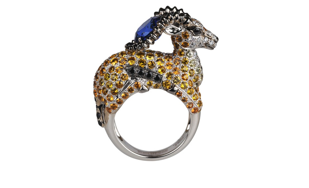 BOUCHERON. Razal ring. White gold, ceylon gadrooned sapphire, orange, yellow and black sapphires, and round diamonds. Price from £38,100.