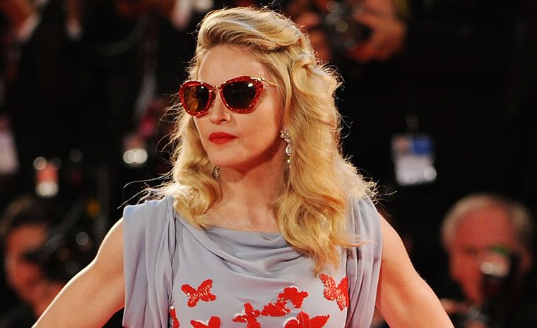 Close up of Madonna at Venice Film Festival 2011 wearing Cartier platinum and diamond pendant earrings