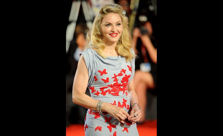 Madonna on the red carpet at the Venice Film Festival 2011 for the premiere of her new film W.E. wearing vintage and contemporary Cartier jewels.