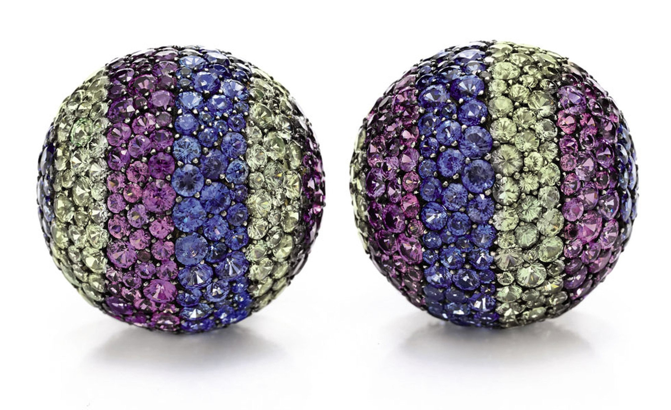 "A Pair of Diamond and Multi-Colored Sapphire ""Ball"" Ear Clips, by JAR Purchased in Paris, December 2001. JAR incorporated varying shades of sapphires to evoke the elusive hue of her eyes. Estimate: $100,000 – 150,000"