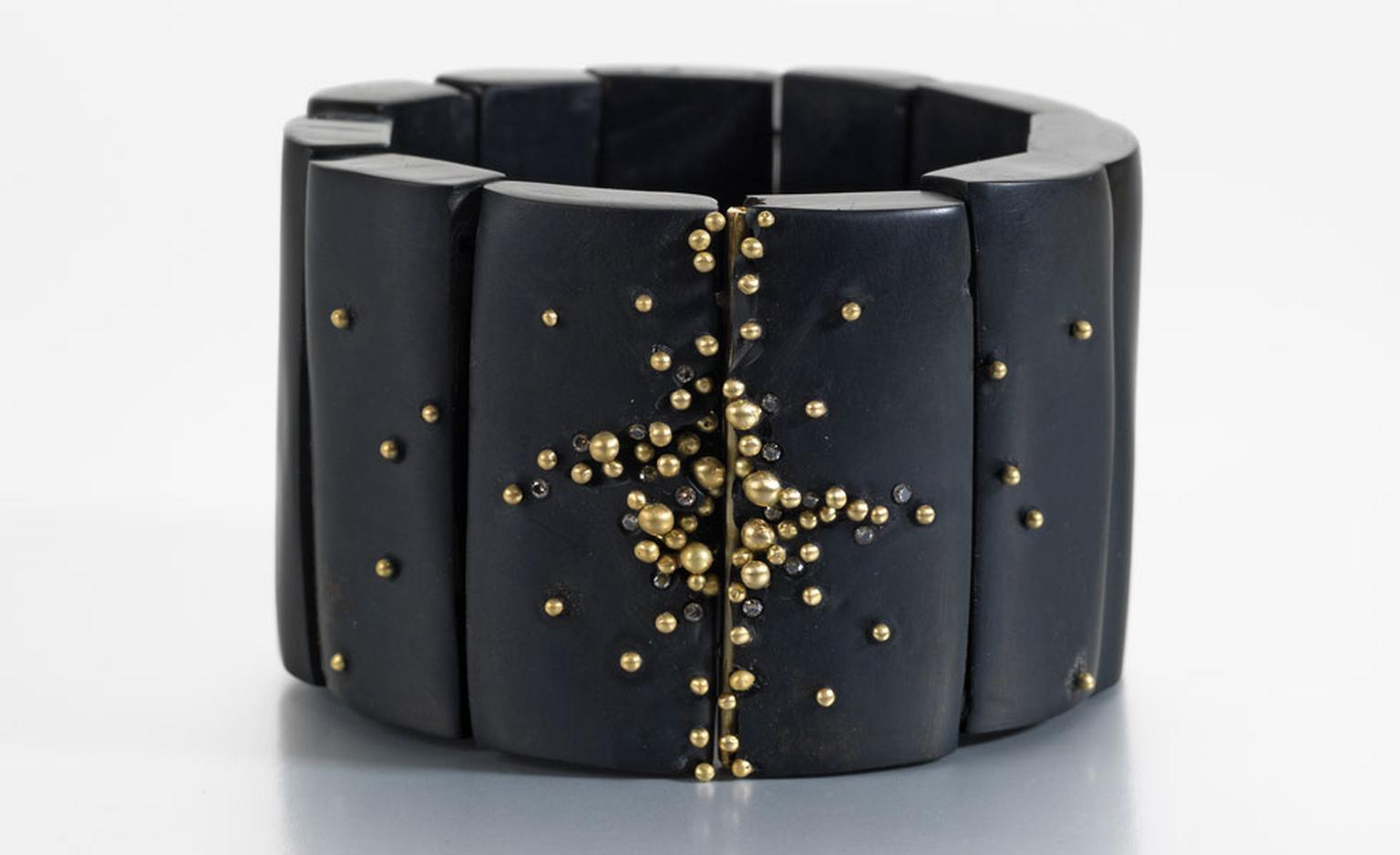 Whitby jet bracelet with gold granulation and champagne diamonds by the award-winning jeweller Jacqueline Cullen and inspired by volcanic eruptions and the flow of lava from crevices. £2,000