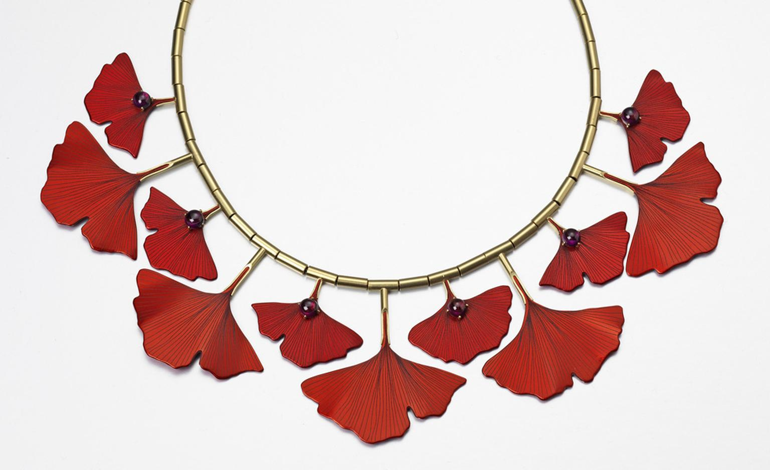 Ginkgo Necklace by Roger Doyle made from 18ct yellow gold set with Rhodonite garnets mounted on photo etched red anodized aluminium.   £3500