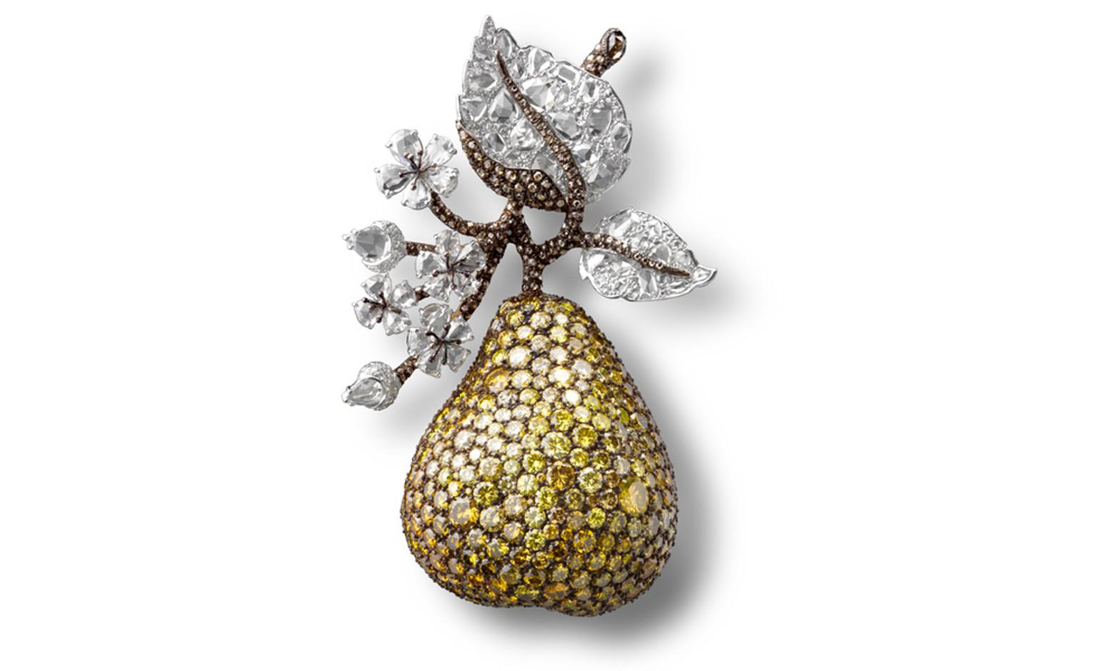 Pear Clip with white, fancy vivid and intense yellow and brown diamonds in platinum and gold.