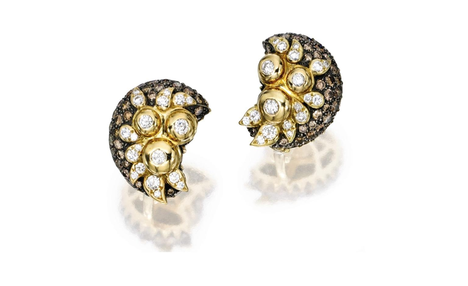 Lot 285 Cooperman & T. &co. 18 Karat Gold Silver Diamond and Colored Diamond Earclips. Est. $ 5/7,000