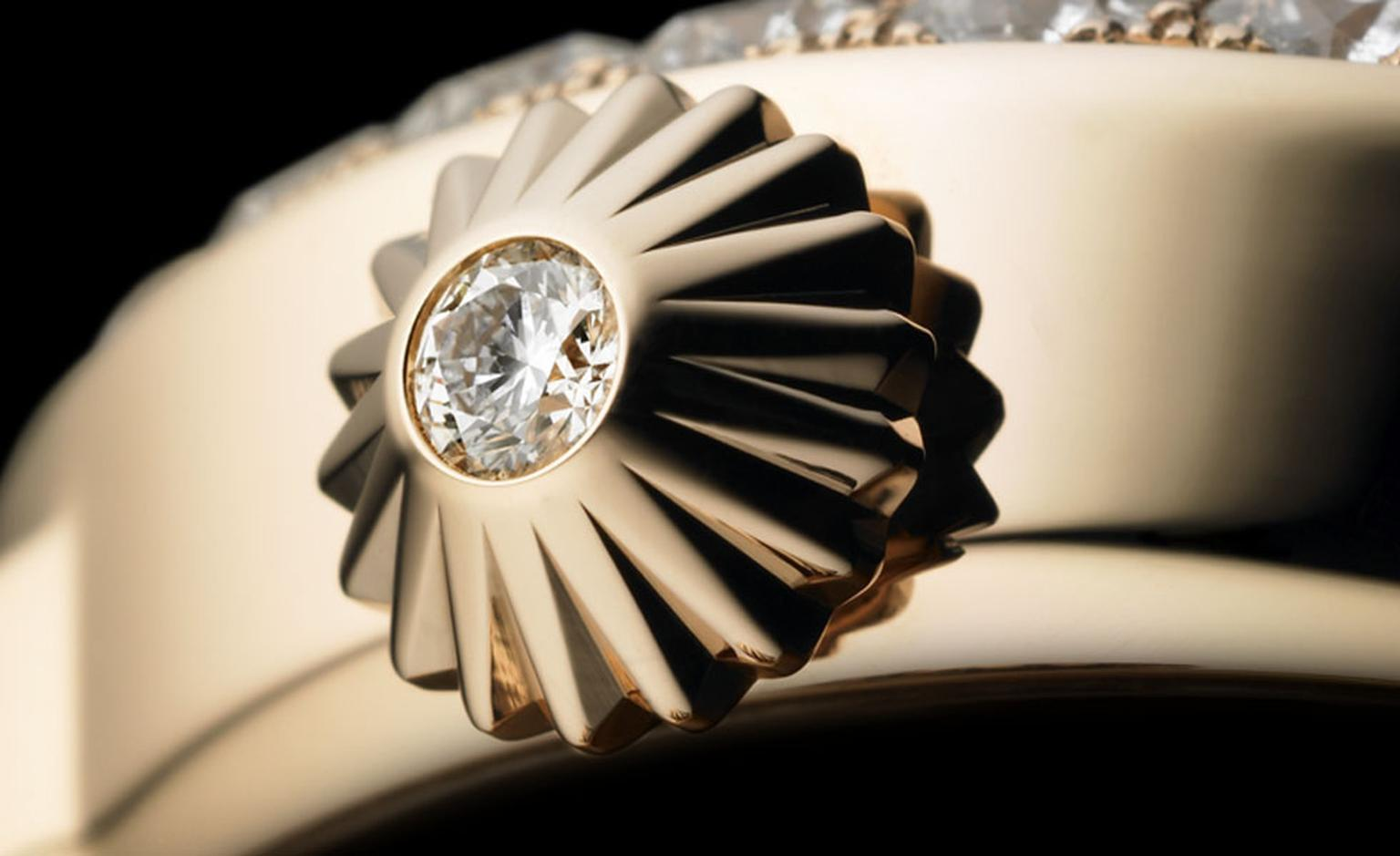 "Backes & Strauss. The Jewel in the Crown. Every Backes & Strauss watch has at least one diamond, set into the crown by hand; it is the Backes & Strauss signature ""The Jewel in the Crown"" which is designed to look like the pavilion of a diamond. ..."
