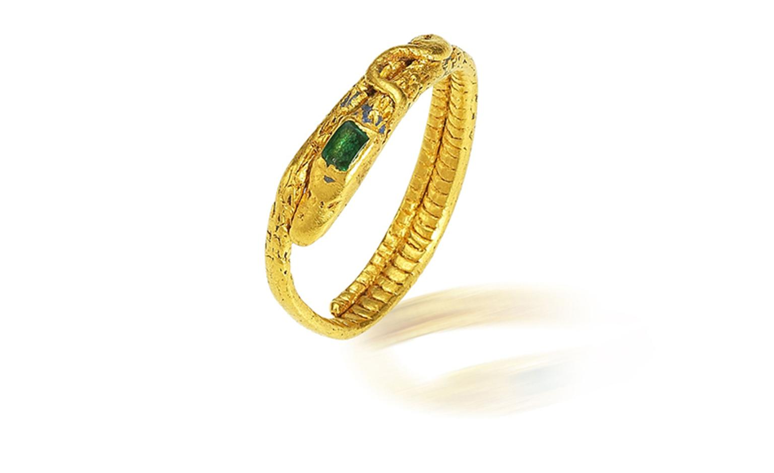 Lot 22. A gold and emerald snake ring, probably 14th-15th century. Estimate £4,000-6,000. SOLD FOR £4,375.