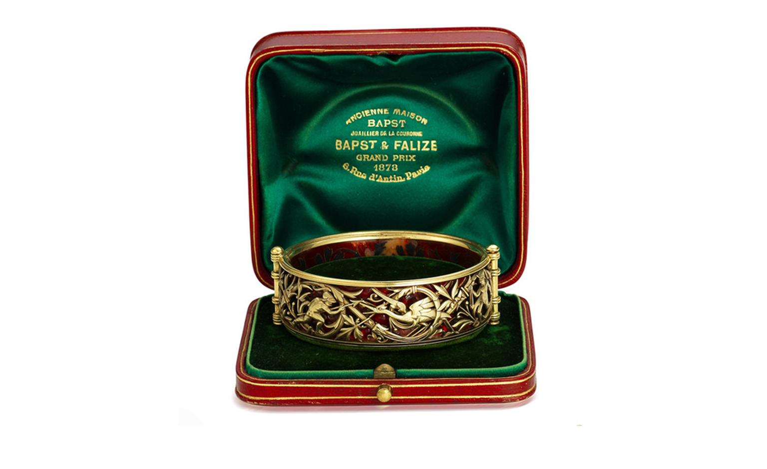 Lot 27. A gold and enamel bangle, by Bapst & Falize, circa 1885. Estimate £6,000-8,000. SOLD FOR ££8,750.
