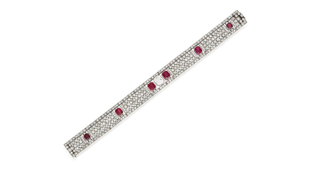 Lot 195. 195 An art deco ruby and diamond bracelet, circa 1930. Estimate £30,000-50,000. SOLD FOR £195.
